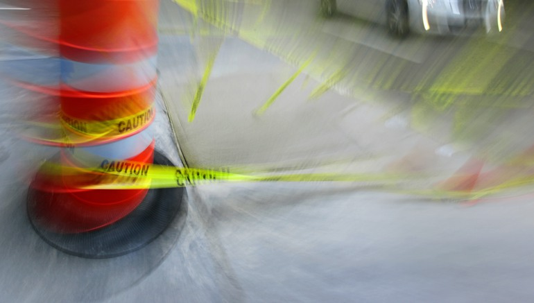 yellow caution tape at construction site with some blurred motion